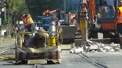 Stock Video Footage of Welder welding n worker pneumatic drills drilling Roadworks