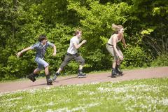 teenagers inline skating - stock photo
