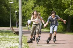 Teenagers inline skating Stock Photos
