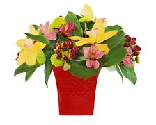 Colorful flower bouquet from orchids and lilies arrangement centerpiece in re Stock Photos