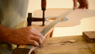 Stock Video Footage of Luthier measures a guitar with a rule