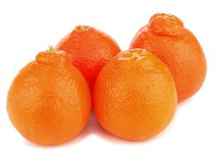 Ripe mineola fruits isolated on white background. Stock Photos