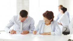 Man and woman signing a contract Stock Footage