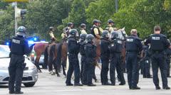 Police dividing FCB Bayern 2 league vs TSV 1860 football club 2 League Munich Stock Footage