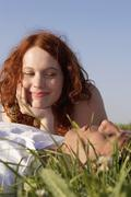 Stock Photo of young couple lying in meadow