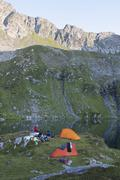 Rumania, Carpathian Mountains, Mountainbikers camping Stock Photos