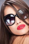 woman with big sun glasses - stock photo