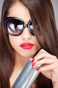 Woman with sun glasses holding can Stock Photos