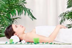 Woman waiting for massage in salon Stock Photos