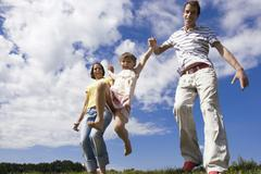 parents with daughter, hand in hand - stock photo