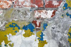 old plaster with remnants of paint - stock photo