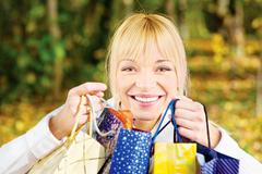 woman with bags after shopping - stock photo