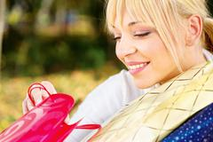 Woman checking out bag content Stock Photos