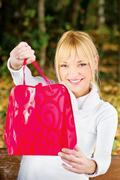 Woman showing her shopping bag Stock Photos