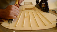 Luthier making a guitar structure with a chisel Stock Footage