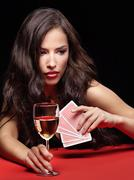 Woman holding gambling cards and wine Stock Photos