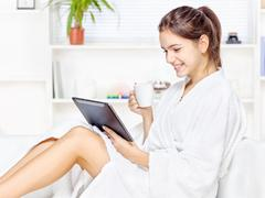 Stock Photo of woman in bathrobe relaxing at home