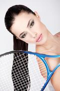 Pretty woman with tennis racket Stock Photos