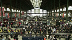 Rush hour in busy trainstation - stock footage