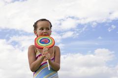 Stock Photo of girl (7-9) holding big lollipop