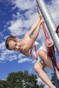 Stock Photo of girl (7-9) climbing on junglegym