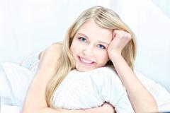 blond woman on pillow - stock photo