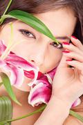 woman with oriental flowers - stock photo