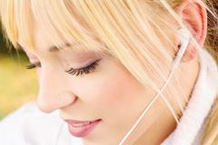 close up of a woman with headphones - stock photo