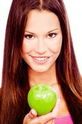 Happy woman with green apple Stock Photos