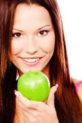 Stock Photo of happy woman with green apple