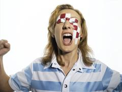 Football fan with Croatian flag painted on face Stock Photos
