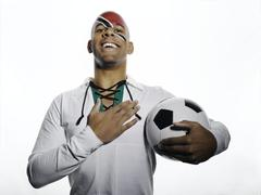 Stock Photo of Football fan with Trinidad and Tobago flag painted on face