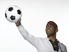 Football fan with Trinidad and Tobago flag painted on face - stock photo