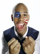 Man with USA flag painted on face - stock photo