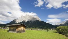Austria, Tyrol, Ehrwald, Built structure in rural scene with mountains in - stock photo