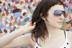 Young woman wearing sun glasses, portrait - stock photo