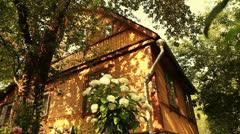 Wooden house in the garden (dolly shot) Stock Footage