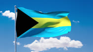Stock Video Footage of Bahamian flag waving over a blue cloudy sky