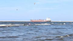 Ship viewed from beach in distance - stock footage