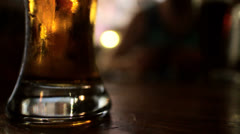 Beer Glass in a Dark Pub Stock Footage