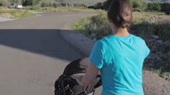 Mother walking baby in countryside Stock Footage