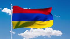 Armenian flag waving over a blue cloudy sky - stock footage