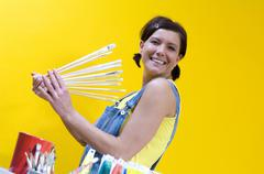 Woman holding brushes Stock Photos