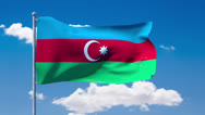 Stock Video Footage of Azerbaijani flag waving over a blue cloudy sky