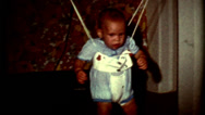Stock Video Footage of 8mm 1960 Baby learning the jumpy funny look on face