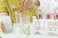Girl in chemical lab Stock Photos