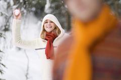 Woman throwing snowball Stock Photos