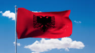 Stock Video Footage of Albanian flag waving over a blue cloudy sky
