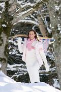 woman carrying sledge - stock photo