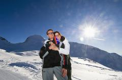Austria, salzburger land, couple embracing in mountains Stock Photos